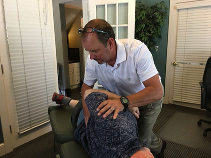 Dr Rob Thiry treats patient