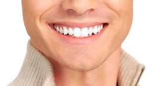 shutterstock-man-smile-closeup-white-tee