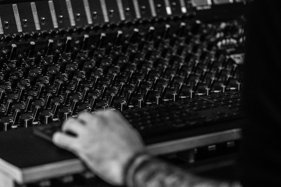 André Six's hand on an audio mixing console at Pieuvre Studio in Brussels, Belgium