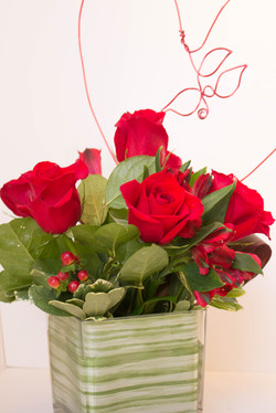 Roses in a glass square vase