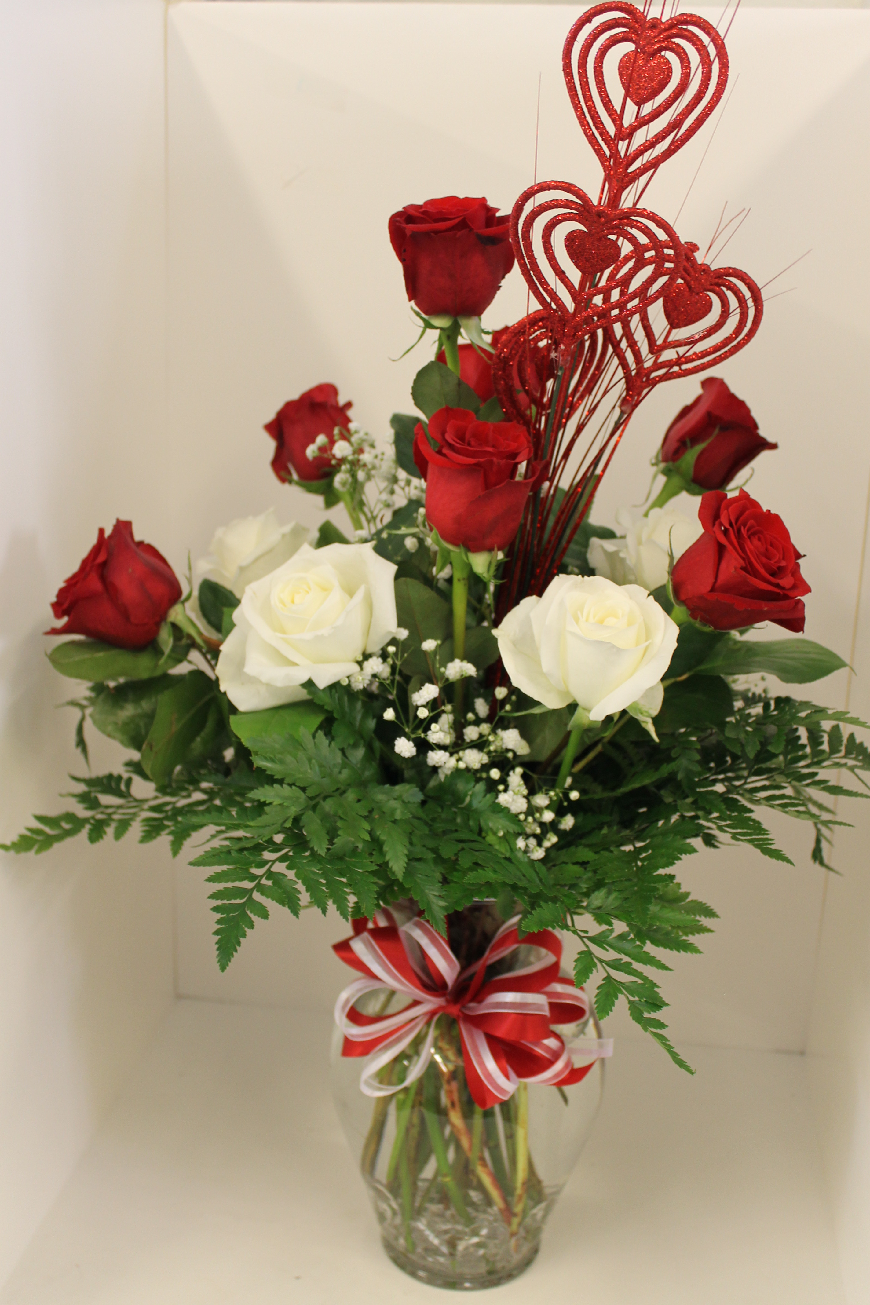 Dozen red and white roses