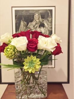 Dozen roses with succulents