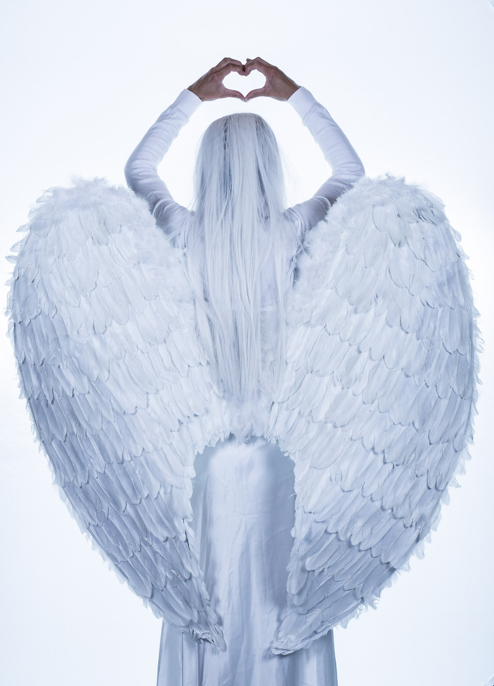 Angel making heart with hands