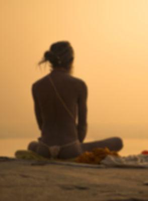 Indian Priest Meditating at Sunset_edited.jpg