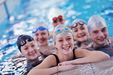 happy teen  group  at swimming pool clas