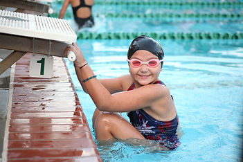 Girl competitive swimmer prepares for ba