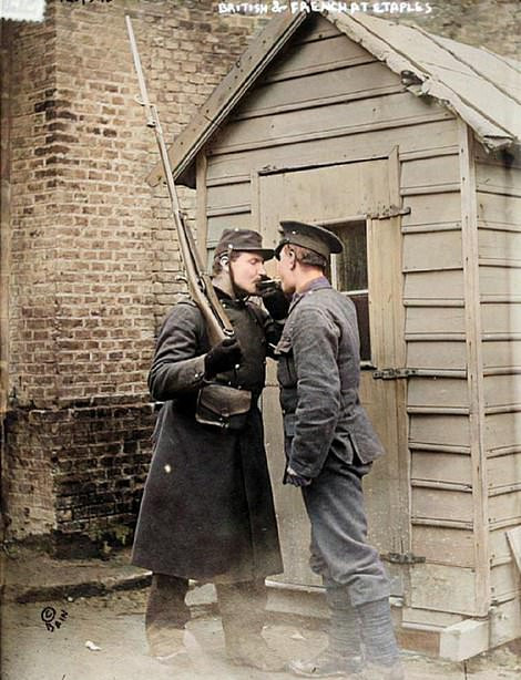 This photograph shows a British soldier sharing a light for a cigarette with his French counterpart in the vast transit camp and military hospital at Etaples near Calais. Some historians believe that the 1918 flu outbreak actually began at the camp's piggery having migrated from poultry to swine and then to humans