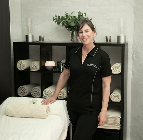 Lauren from Hands On Therapeutic Massage standing beside massage bed in Mukinbudin