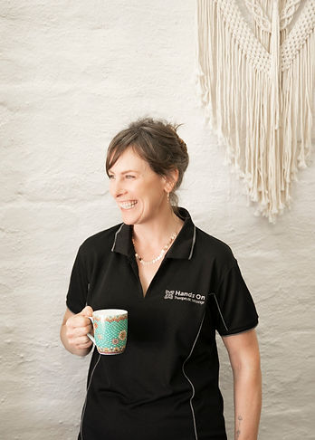 Lauren from Hands on Therapeutic Massage in Central Wheatbelt having a cup of tea with a smile