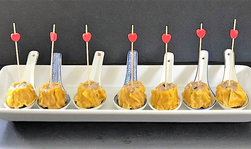 Siew mai on china spoon with picks