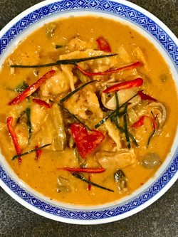 Tom yum chicken curry in bowl