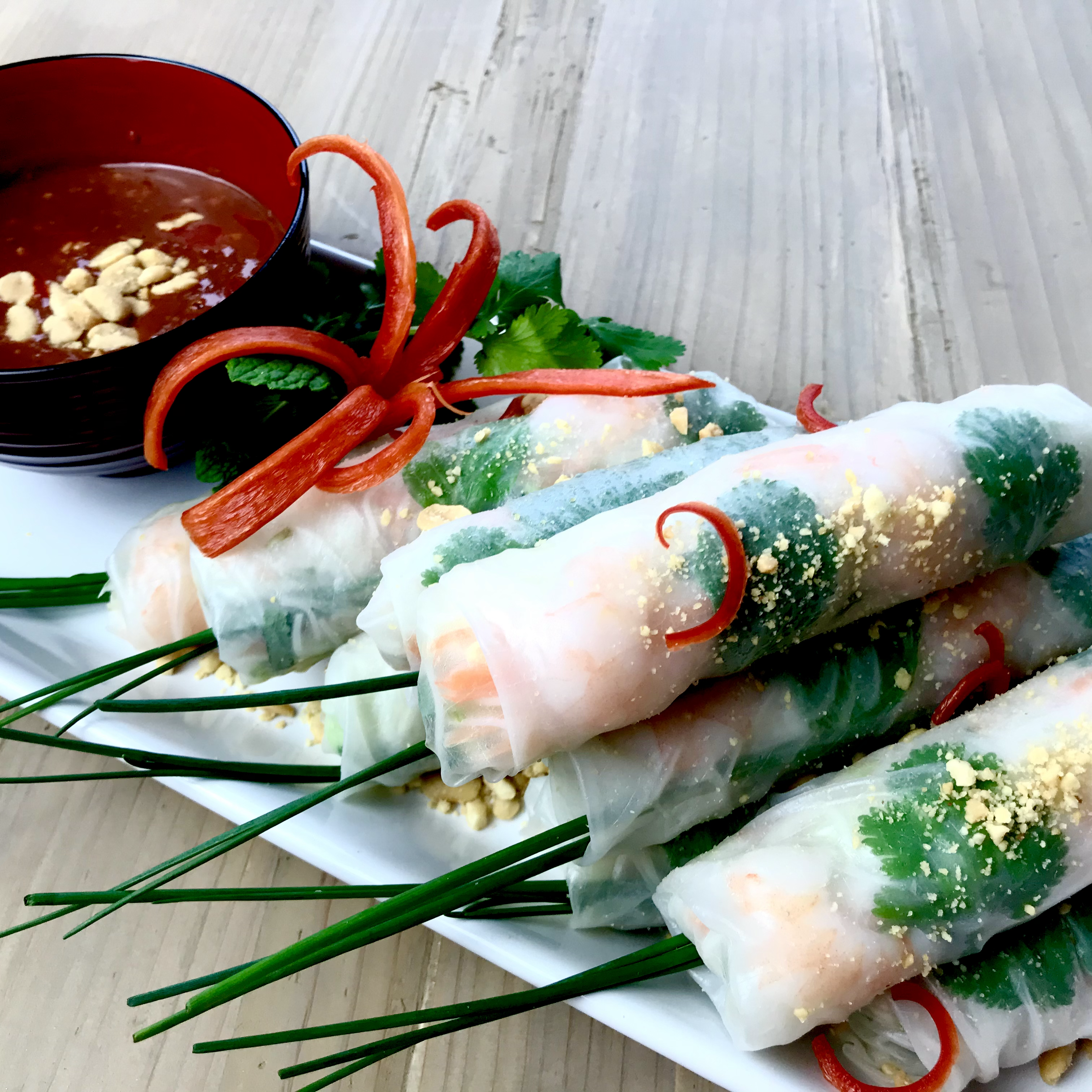 Summer rolls with chive garnish