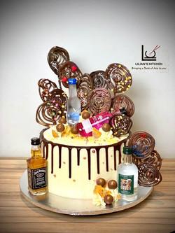 Hand piped chocolate swirl lollipop cake