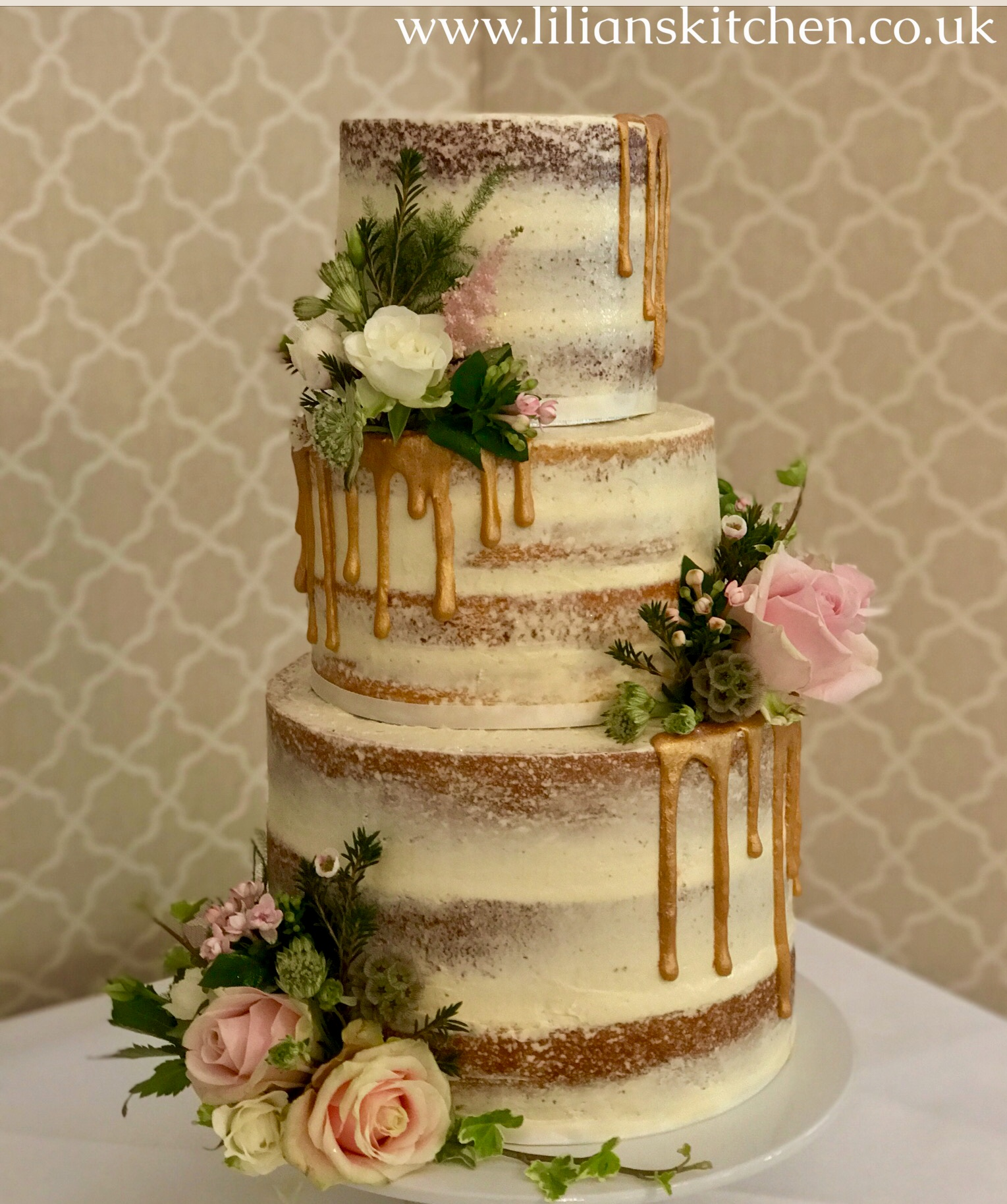 Gold Drip Wedding Cake _edited