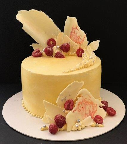 Lemon Syllabub Cake with White Chocolate Shards and Fresh Raspberries