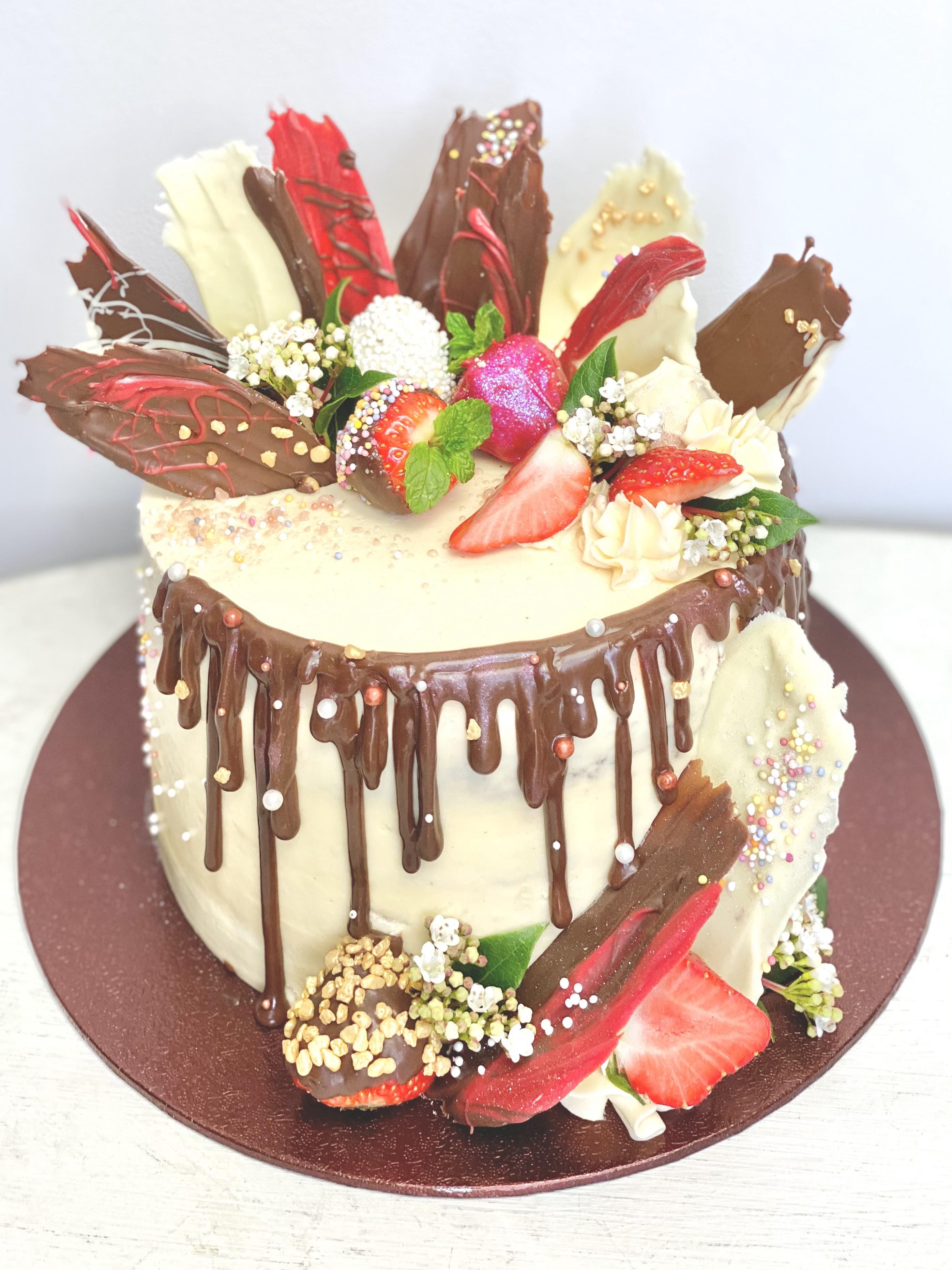 Strawberry chocolate shards drip cake