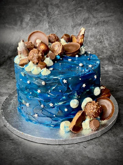 Galaxy cake with client's favourite selection of chocolates- Gaylian Belgian Seashells, Reese's Pean