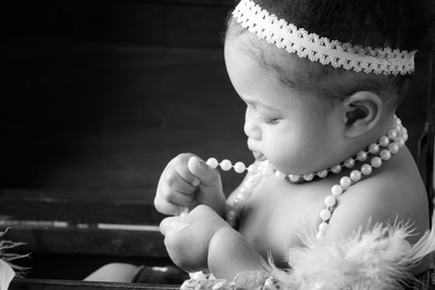 6 month old girl with pearls black and white by bmariephotography