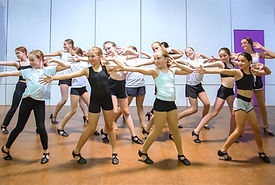 Studio Intensity Jazz dancers reaching