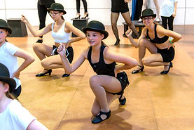 Studio Intensity jazz dancers kneeling