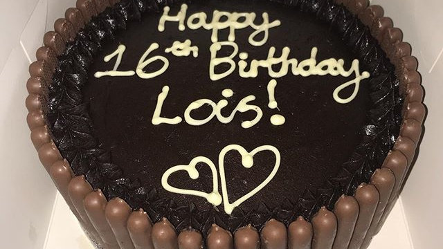 Chocolate cake, chocolate finger edge and white chocolate writing