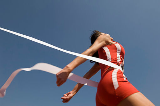 A photo of a runner going over the finish line.