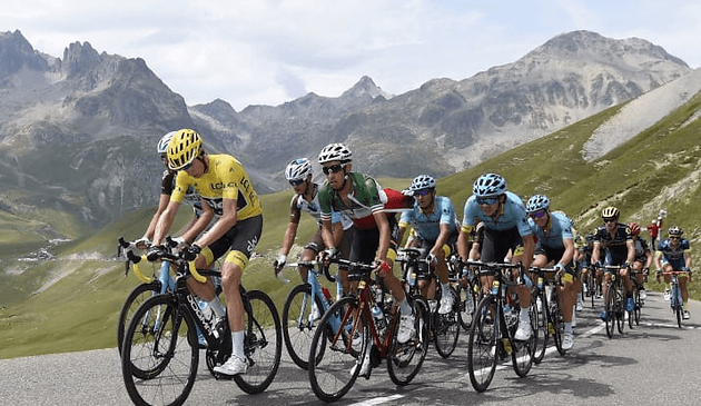A photo of cyclists in a race up a mountain.