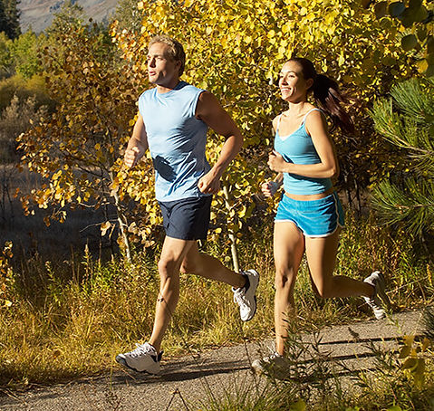 A photo of a couple running.