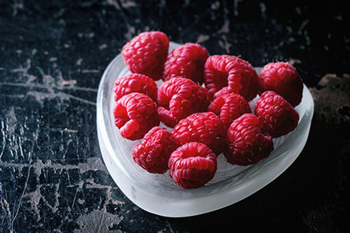 Raspberry in a love heart shaped bowl.