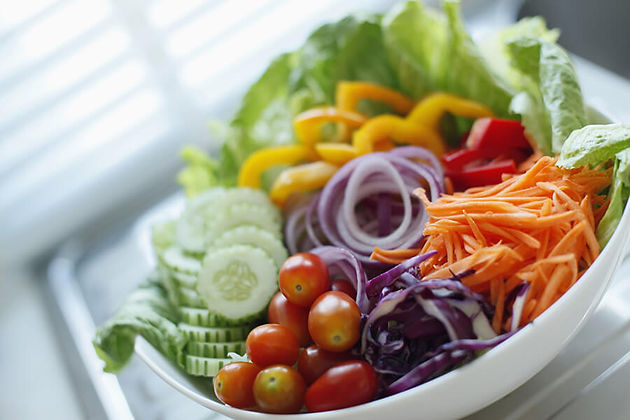 A photo of a bowl of salad.