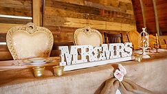Mr & Mrs sign at head table