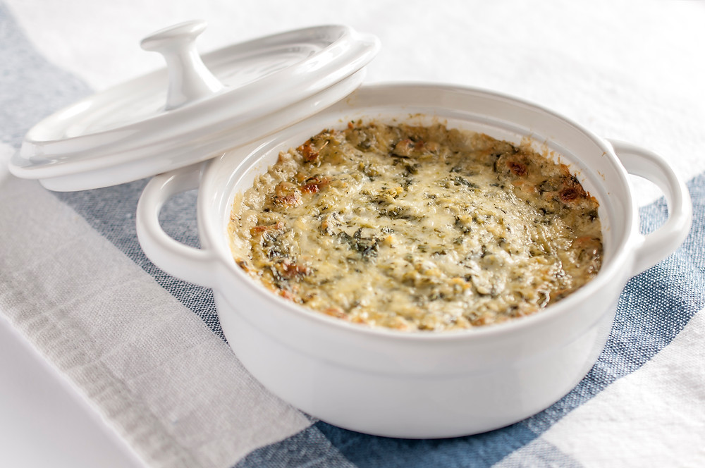 artichoke dip with artichoke hearts, sour cream, mayonnaise, parmesan cheese and onions