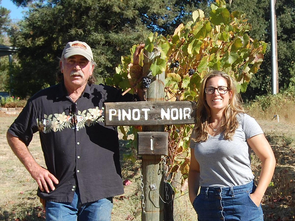 Ken Nerlove and his daughter Elise Nerlove in a 2019 photo at their vineyard above Jameson Canyon. They are members of Save the Family Farms, a group that wants farmers to be able to hold wine tastings at their farms in Napa County.
