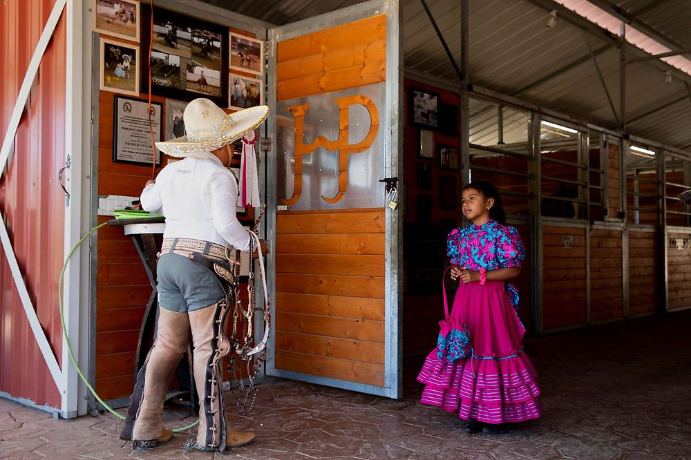 Andres Puentes, 11, and Paula Puentes, 7, dress in traditional charro clothing before riding their horses at Honrama Ranch, where their parents' winery produces 1,200 cases per year.  | Jessica Christian / The Chronicle