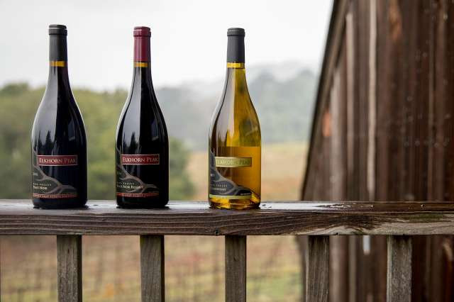 Elkhorn Peak Cellars' Pinot Noir, Pinot Noir Reserve and Chardonnay bottles. The grapes for these wines are grown at the Nerlove's family vineyard but made in a winery offsite. Photo: Jessica Christian / The Chronicle