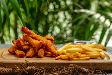 fried-breaded-chicken-breast-strips-with-ketchup-french-fries-wooden-board.jpeg