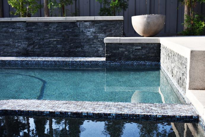 Pot on side of pool