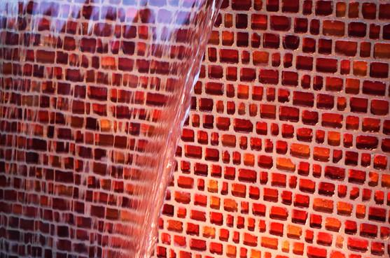 Red Glass Backsplash on Waterfall Feature
