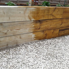 Raised beds sanded and treated.