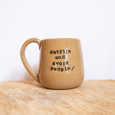 Speckled beige mug with text