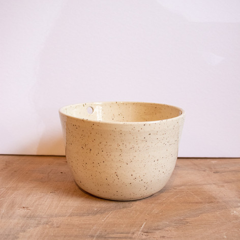 Small speckled white ceramic bowl