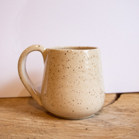 Speckled white ceramic mug