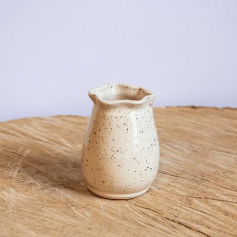 Small white speckled ceramic vase