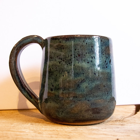 Green and brown ceramic mug