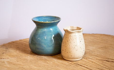 Small blue and speckled white ceramic va