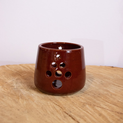 Red ceramic tree tea candle