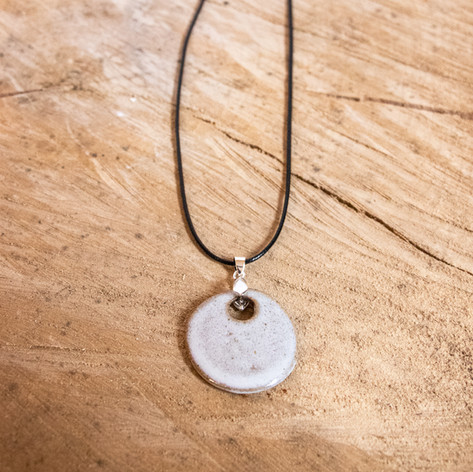 White speckled round ceramic pendant