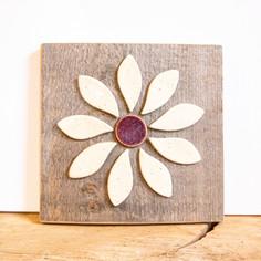 White ceramic flower on barnwood