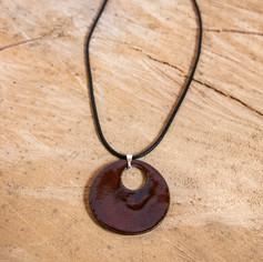 Red and black round ceramic pendant