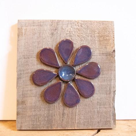 Purple ceramic flower on barnwood